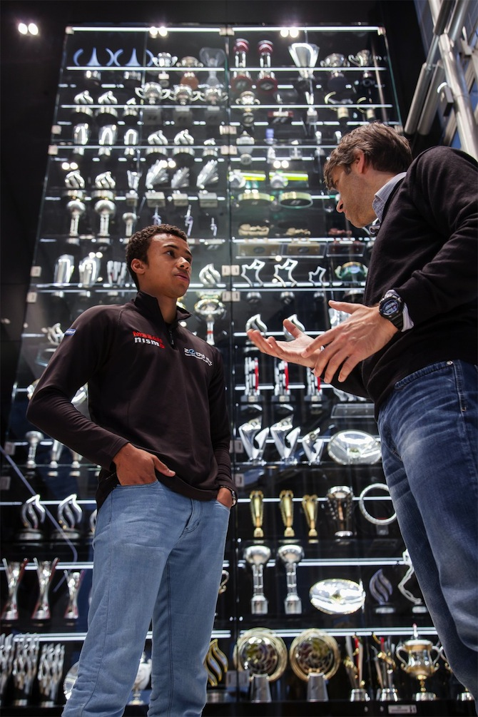 Jann Mardenborough and Andy Damerum in front of Infiniti Red Bull Racing-s impressive trophy collection